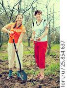 Купить «women planting tree at orchard», фото № 25854637, снято 8 мая 2011 г. (c) Яков Филимонов / Фотобанк Лори
