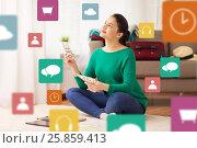 Купить «happy woman with money and travel map at home», фото № 25859413, снято 18 января 2017 г. (c) Syda Productions / Фотобанк Лори