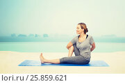Купить «woman making yoga in twist pose on mat», фото № 25859621, снято 13 ноября 2015 г. (c) Syda Productions / Фотобанк Лори