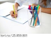 Купить «girl drawing with felt-tip pen in notebook», фото № 25859801, снято 31 июля 2013 г. (c) Syda Productions / Фотобанк Лори