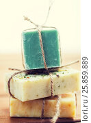 Купить «close up of handmade soap bars on wood», фото № 25859889, снято 21 декабря 2015 г. (c) Syda Productions / Фотобанк Лори