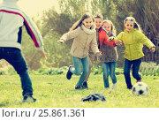 Купить «children running after ball», фото № 25861361, снято 2 июля 2020 г. (c) Яков Филимонов / Фотобанк Лори