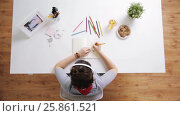 Купить «woman drawing picture in notebook at home desk», видеоролик № 25861521, снято 22 марта 2017 г. (c) Syda Productions / Фотобанк Лори