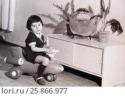 Купить «Мальчик сидит на игрушечном самолете в детском саду», фото № 25866977, снято 7 декабря 2019 г. (c) Игорь Кутателадзе / Фотобанк Лори