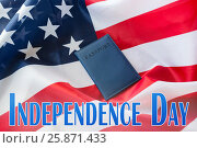 Купить «independence day words, american flag and passport», фото № 25871433, снято 6 мая 2016 г. (c) Syda Productions / Фотобанк Лори