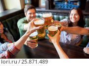 Купить «happy friends drinking beer at bar or pub», фото № 25871489, снято 14 июля 2016 г. (c) Syda Productions / Фотобанк Лори
