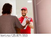 Купить «happy man delivering parcel boxes to customer home», фото № 25871553, снято 3 декабря 2016 г. (c) Syda Productions / Фотобанк Лори