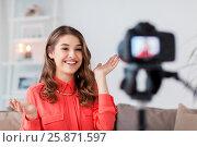 Купить «woman with camera recording video at home», фото № 25871597, снято 22 декабря 2016 г. (c) Syda Productions / Фотобанк Лори