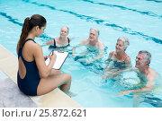Купить «Female instructor writing while instructing senior swimmers at poolside», фото № 25872621, снято 12 декабря 2016 г. (c) Wavebreak Media / Фотобанк Лори