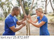 Купить «Male trainer assisting woman in rope climbing during obstacle course», фото № 25872697, снято 24 ноября 2016 г. (c) Wavebreak Media / Фотобанк Лори