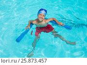 Купить «High angle view of cheerful boy swimming in pool», фото № 25873457, снято 12 декабря 2016 г. (c) Wavebreak Media / Фотобанк Лори
