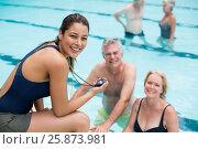 Купить «Young female trainer and senior swimmers at poolside», фото № 25873981, снято 12 декабря 2016 г. (c) Wavebreak Media / Фотобанк Лори