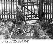 Купить «Маленькая девочка на трехколесном велосипеде, фотография 1964 года», фото № 25884041, снято 17 августа 2018 г. (c) Галина Ермолаева / Фотобанк Лори