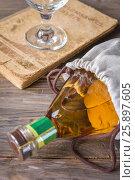 Wine on wooden background. wine in tall glass. Стоковое фото, фотограф Nunik Varderesyan / Фотобанк Лори