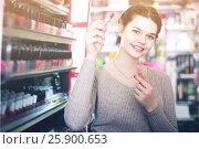 Купить «female customer looking for lipstick in cosmetics shop», фото № 25900653, снято 21 февраля 2017 г. (c) Яков Филимонов / Фотобанк Лори