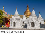 Купить «Kuthodaw Pagoda contains the worlds biggest book. There are 729 white stupas with caves with a marble slab inside - page with buddhist inscription. Mandalay, Myanmar», фото № 25905681, снято 17 февраля 2020 г. (c) BE&W Photo / Фотобанк Лори