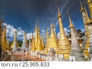 Купить «Golden stupas, Shwe Inn Thein Paya, Inthein, Inle Lake, Myanmar», фото № 25905833, снято 17 февраля 2020 г. (c) BE&W Photo / Фотобанк Лори