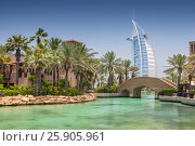 "Купить «View of the world's first seven stars luxury hotel Burj Al Arab ""Tower of the Arabs"", Madinat Jumeirah in Dubai with palms tree, United Arab Emirates», фото № 25905961, снято 19 ноября 2018 г. (c) BE&W Photo / Фотобанк Лори"