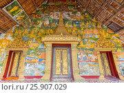 Wall painting of the life of Buddha in front Ban Xieng Muan temple, Luang Prabang, Laos. Стоковое фото, агентство BE&W Photo / Фотобанк Лори