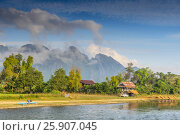 Mountain view along the Nam Song River in Vang Vieng, Laos. Стоковое фото, агентство BE&W Photo / Фотобанк Лори