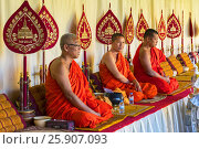 Купить «Pha That Luang, seated buddhist monks chanting and reading prayers at a ceremony. Vientiane. Laos», фото № 25907093, снято 22 мая 2019 г. (c) BE&W Photo / Фотобанк Лори
