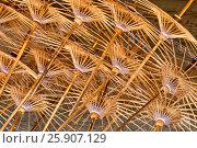 Купить «Wood shafts in an umbrella factory, Chiang Mai, Thailand», фото № 25907129, снято 28 мая 2018 г. (c) BE&W Photo / Фотобанк Лори