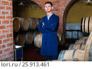 Купить «portrait of young male wine maker in coat working in winery cellaryoung wine maker in cellarman, male, young, working, winery, wine, cellar, wood, aging, standing, looking, expert, manufactory, uniform, bottler, equipment, section, alcohol, beverage, winemaking, professional, occupation, small, tank, processing, barrel, compartment, container, positive, european, caucasian, 20s, 30-35, portrait, examining, cheerful, glad, production, taste, factory, employed, showing, visiting, coveralls, unit, one, promoting, checking, coat, quality, control, craft, man, male, young,working, winery, wine, standing, cellar, wood, aging, looking, expert, manufactory, uniform, bottler, equipment, section, alcohol, bottle, beverage, winemaking, professional, occupation, processing, barrel, compartment, container, positive, caucasian, american, 30s, 25-29, expertise, smiling, producer, one, segment, label, selective, check-up, attentive, leaning,», фото № 25913461, снято 12 декабря 2017 г. (c) Яков Филимонов / Фотобанк Лори