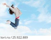 Купить «Woman jumping ecstatic in cloudy sky», фото № 25922889, снято 23 января 2019 г. (c) Wavebreak Media / Фотобанк Лори