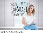 Woman with tablet and Share text with drawings graphics. Стоковое фото, агентство Wavebreak Media / Фотобанк Лори