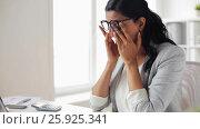 Купить «businesswoman rubbing tired eyes at office», видеоролик № 25925341, снято 16 марта 2017 г. (c) Syda Productions / Фотобанк Лори