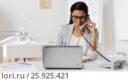 Купить «businesswoman calling on phone at office», видеоролик № 25925421, снято 16 марта 2017 г. (c) Syda Productions / Фотобанк Лори