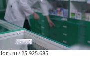 Купить «Close-up of pills in blister pack lying on counter», видеоролик № 25925685, снято 2 апреля 2017 г. (c) Швец Анастасия / Фотобанк Лори