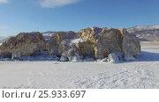 Купить «Аэросъемка с воздуха. Зима. Озеро Байкал», видеоролик № 25933697, снято 13 февраля 2017 г. (c) Виталий Зверев / Фотобанк Лори