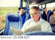 Купить «happy senior man reading newspaper in travel bus», фото № 25938621, снято 21 октября 2015 г. (c) Syda Productions / Фотобанк Лори