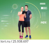 Купить «happy sportive man and woman with tablet pc», фото № 25938697, снято 2 марта 2017 г. (c) Syda Productions / Фотобанк Лори