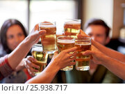 Купить «happy friends drinking beer at bar or pub», фото № 25938717, снято 14 июля 2016 г. (c) Syda Productions / Фотобанк Лори