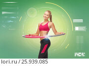 young sporty woman with hula hoop. Стоковое фото, фотограф Syda Productions / Фотобанк Лори