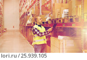 Купить «man with clipboard in safety vest at warehouse», фото № 25939105, снято 9 декабря 2015 г. (c) Syda Productions / Фотобанк Лори