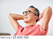 Купить «man in glasses relaxing or dreaming at home», фото № 25939189, снято 16 декабря 2016 г. (c) Syda Productions / Фотобанк Лори