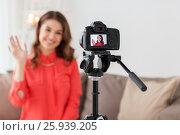 Купить «happy woman with camera recording video at home», фото № 25939205, снято 22 декабря 2016 г. (c) Syda Productions / Фотобанк Лори