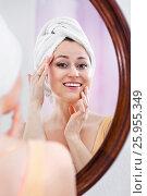 Купить «Woman having a look at her face at the mirror», фото № 25955349, снято 5 июля 2020 г. (c) Яков Филимонов / Фотобанк Лори