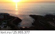 Купить «Закат над Атлантическим океаном. Остров Гомера на горизонте. Плая Параисо (Playa Paraiso), Тенерифе, Канары, Испания», видеоролик № 25955377, снято 7 февраля 2016 г. (c) Кекяляйнен Андрей / Фотобанк Лори