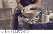 Купить «Young potter in uniform», видеоролик № 25970613, снято 2 марта 2017 г. (c) Raev Denis / Фотобанк Лори