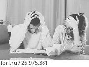 Купить «Couple struggling to pay bills», фото № 25975381, снято 18 марта 2017 г. (c) Яков Филимонов / Фотобанк Лори