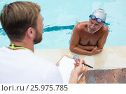 Купить «Swim coach interacting with senior man», фото № 25975785, снято 12 декабря 2016 г. (c) Wavebreak Media / Фотобанк Лори
