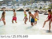 Купить «Young couples in beachwear enjoying in sea», фото № 25976649, снято 17 января 2017 г. (c) Wavebreak Media / Фотобанк Лори