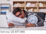 Купить «Tired man sleeping at home having too much work», фото № 25977965, снято 5 января 2017 г. (c) Elnur / Фотобанк Лори