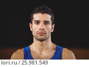Купить «Male basketball player standing in basketball court», фото № 25981549, снято 18 февраля 2017 г. (c) Wavebreak Media / Фотобанк Лори