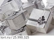 Купить «Many silver gifts in a pile on white», фото № 25990325, снято 3 сентября 2011 г. (c) Tatjana Romanova / Фотобанк Лори
