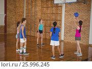 Купить «High school kids playing basketball», фото № 25996245, снято 18 февраля 2017 г. (c) Wavebreak Media / Фотобанк Лори
